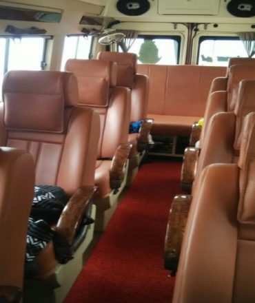 book 12 seater tempo traveller